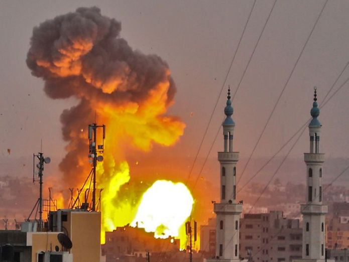 A picture taken on July 20, 2018 shows a fireball exploding in Gaza City during Israeli bombardment. - Israeli aircraft and tanks hit targets across the Gaza Strip on July 20 after shots were fired at troops on the border, the army said, with Hamas reporting several members of its military wing killed in the latest flare-up in months of tensions  Israeli soldier and four Palestinians killed in Gaza Strip clashes skynews hamas israel palestinians 4367359