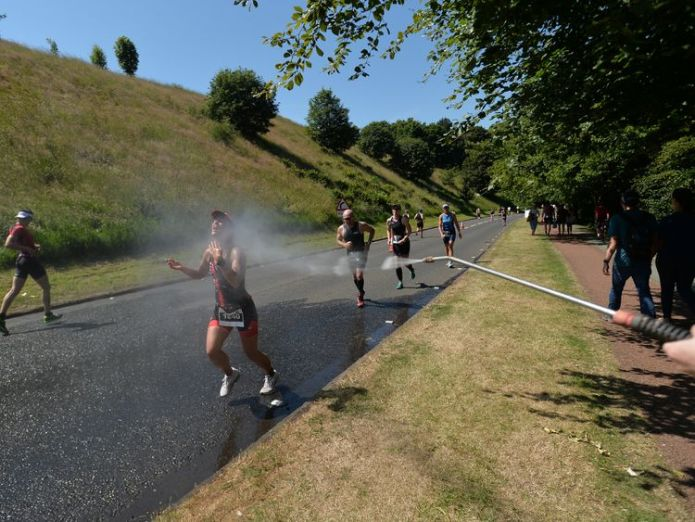 Runners in Scotland cool off during the Iron Man triathlon  Proof of global warming? Historical heat records broken across globe skynews ironman scotland weather 4351431