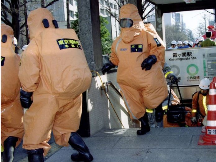 File photo of special chemical control unit members emerging from an entrance to the Kasumigaseki subway station in Tokyo March 20, 1995  Final members of sarin attack cult are executed in Japan skynews kasumigaseki japan 4371730