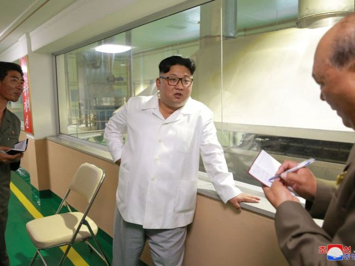 Aides wrote down what Mr Kim was saying at the potato powder factory  Kim Jong Un snubbed Mike Pompeo for potato farm visit, state media suggests skynews kim jong un north korea 4358483