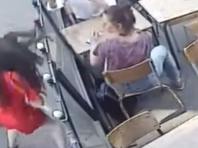 People in the cafe look on in horror as Ms Laguerre  is atacked  Man arrested after woman hit in face outside Paris cafe skynews marie laguerre attack 4375922