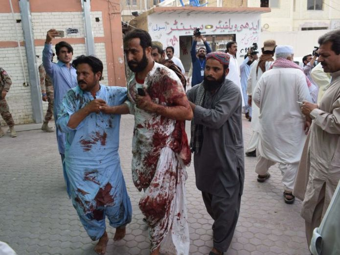 Injured are taken to hospital after a suicide bomber hits Pakistan  Suicide bombers kill 132 including political candidate in Pakistan election violence skynews pakistan suicide bomber 4361562