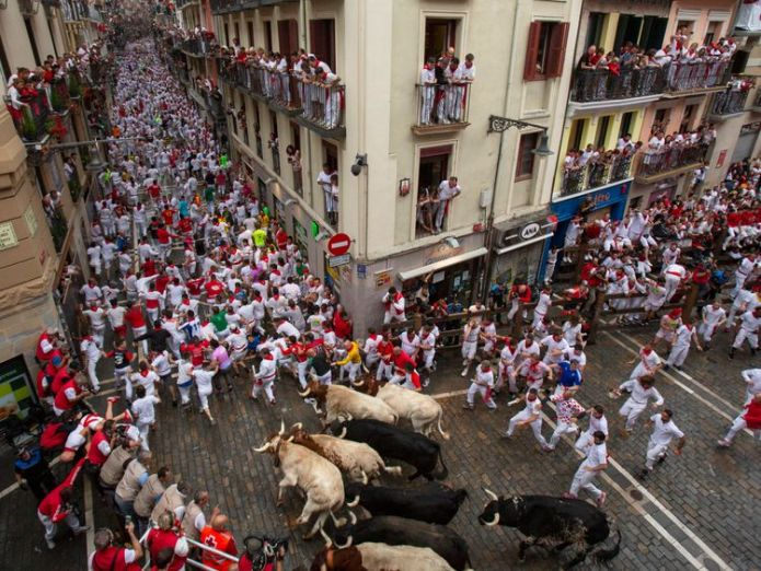Hundreds of people take part in the running of the bulls each day during San Fermin  Man gored and four badly injured on first day of Pamplona bull run skynews pamplona bull run 4356196