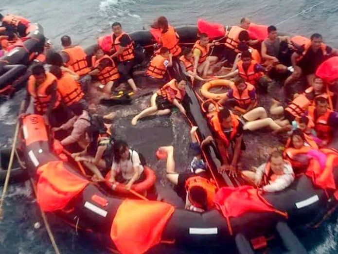 Survivors in a life raft. Pic: Phuket Provincial EOC  Death toll climbs to 27 and dozens still missing skynews phuket thailand tourist boats capsise 4354485