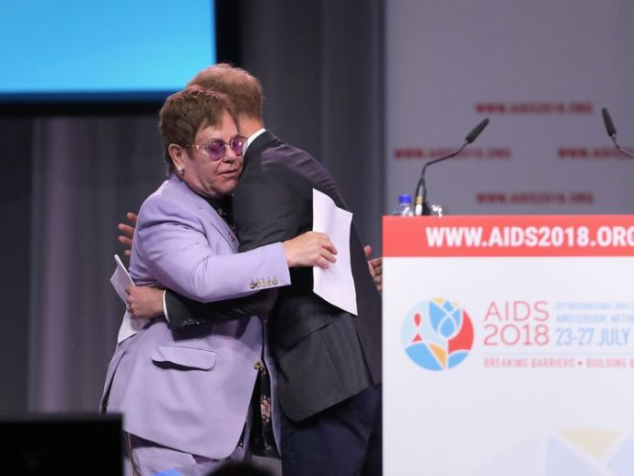 The Duke of Sussex hugs Sir Elton John during the Aids 2018 summit in Amsterdam  Prince Harry joins Sir Elton John to launch AIDS initiative in Amsterdam skynews prince harry elton john 4369978
