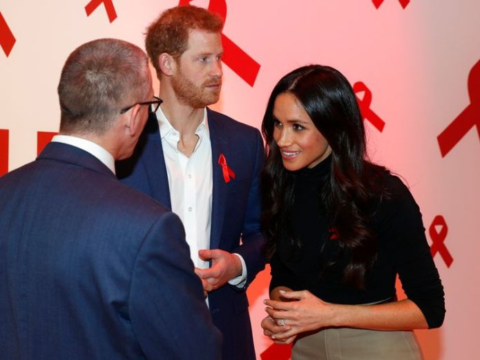 Prince Harry and Meghan Markle at the Terrence Higgins Trust World AIDS Day charity fair in 2017  Prince Harry joins Sir Elton John to launch AIDS initiative in Amsterdam skynews prince harry meghan markle 4370013