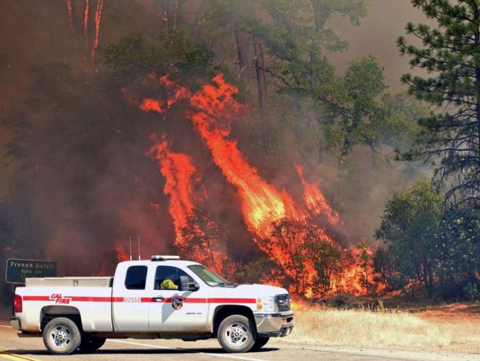 Flames engulf trees near a road during the Carr fire in Redding  Monster California blaze kills two firefighters skynews redding fire california 4373884