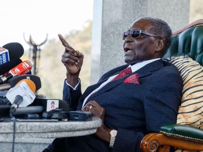 Former Zimbabwean President Robert Mugabe speaks at a surprise press conference at his residence 'Blue Roof '  Zimbabweans vote in first election without Robert Mugabe on ballot paper skynews robert mugabe zimbabwe 4374964
