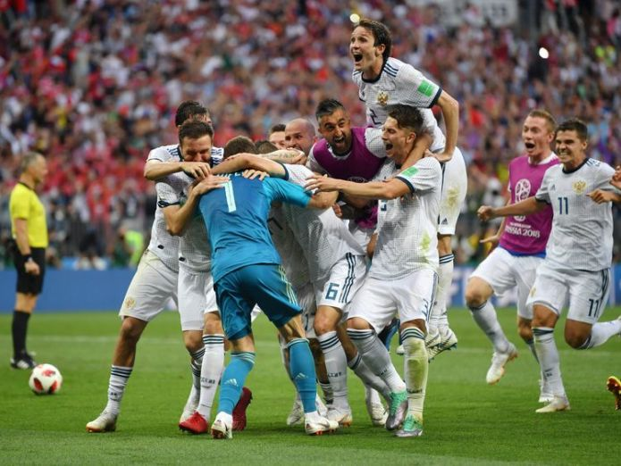 Russian players celebrate their penalties win over Spain in the Luzhniki Stadium, Moscow  Russia stun Spain on penalties to make last eight skynews russia world cup 4350772