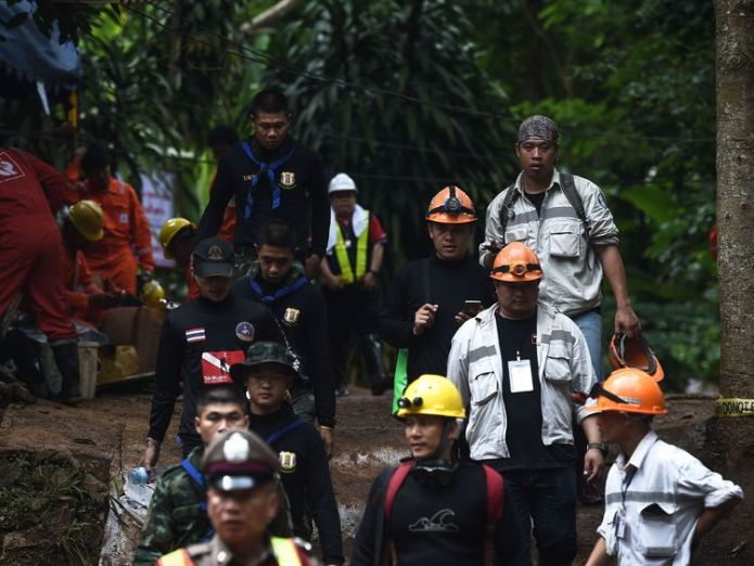 Thai rescue workers and technicians are seen at the Tham Luang cave area  Trapped Thai cave boys write heartfelt notes to parents as football coach apologises skynews thai cave tham luang 4354986