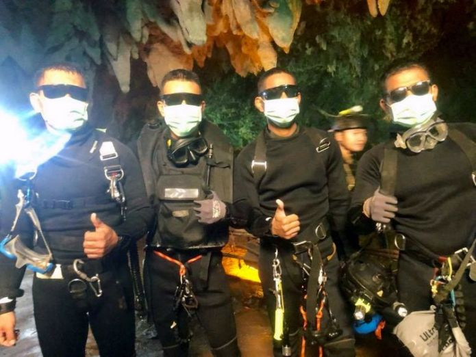 Four Thai navy SEALs give a thumbs up as they leave the cave  First pictures of youngsters recovering in hospital skynews thai navy seals thailand 4358610