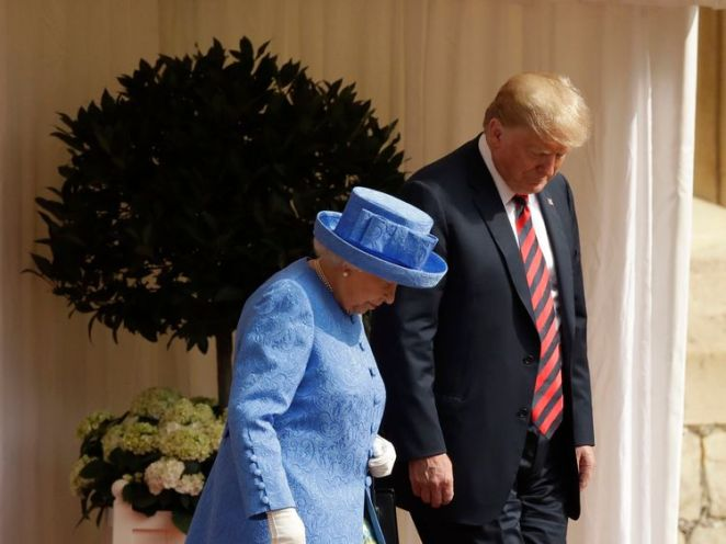 US President Donald Trump and Queen Elizabeth II prepare to inspect a Guard of Honour, formed of the Coldstream Guards, at Windsor Castle, Windsor