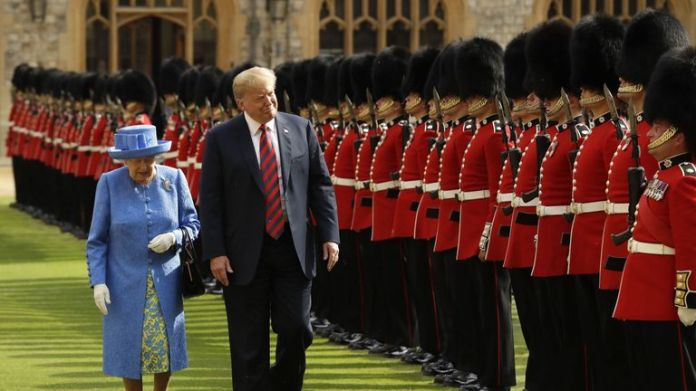The Queen and Donald Trump inspect an honor guard at Windsor Castle