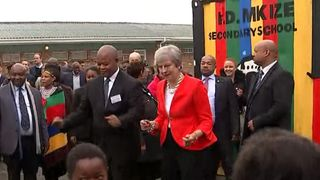 Theresa May dances outside a school in Cape Town  Theresa May in 'unashamed' vow to ensure foreign aid spending benefits UK skynews theresa may south africa 4403381