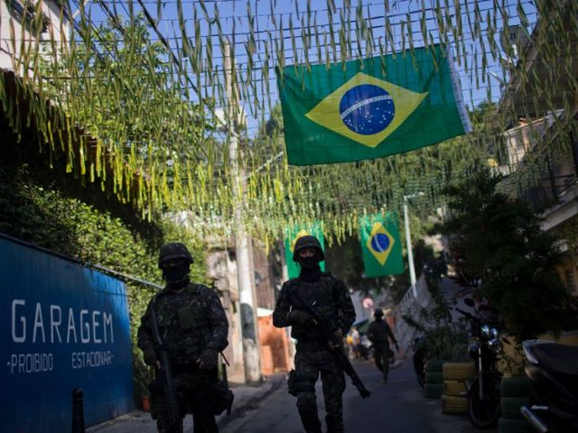 The Brazil Armed Forces patrol the favelas in Rio de Janeiro in a bid to prevent violence