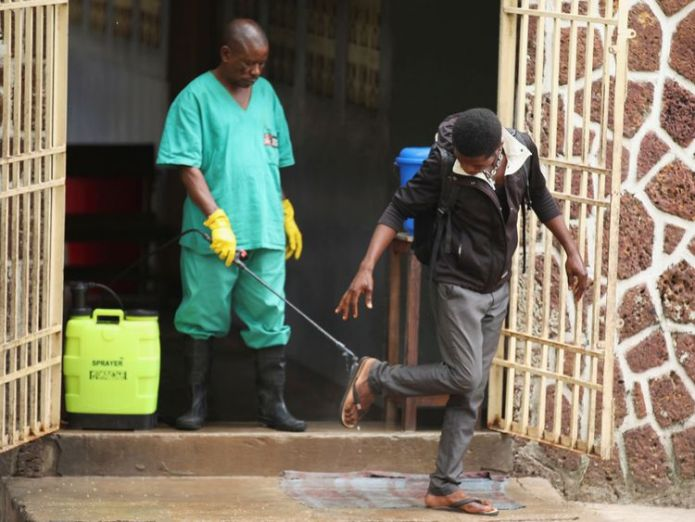A health worker sprays a visitor with chlorine after leaving the isolation facility, prepared to receive suspected Ebola cases, at the Mbandaka General Hospital, in Mbandaka, Democratic Republic of Congo May 20, 2018  WHO vows to fight new Ebola outbreak in DR Congo skynews congo ebola mbandaka 4377899