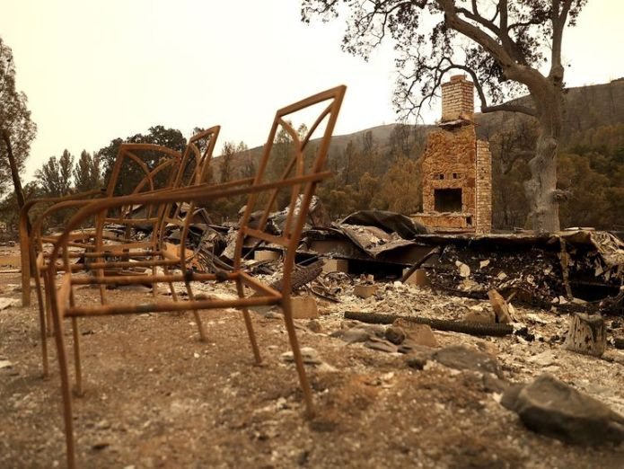 Chairs sit in the remains of a home that was destroyed by the Medocino Complex fire on August 7, 2018 near Clearlake Oaks, California. The Mendocino Complex Fire, which is made up of the River Fire and Ranch Fire, has surpassed the Thomas Fire to become the largest wilfire in California state history with over 280,000 acres charred and at least 75 homes destroyed. (Photo by Justin Sullivan/Getty Images)  California faces worst fire season as blazes continue to burn skynews fire california 4383574