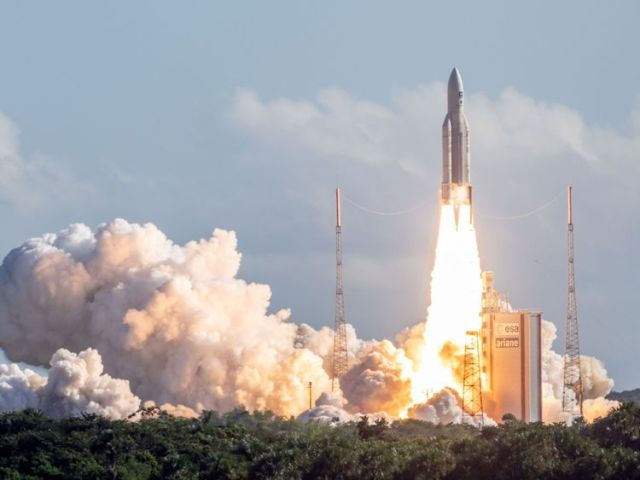 TOPSHOT - The Ariane 5 rocket, with four Galileo satellites onboard, takes off from the launchpad in the European Space Centre (Europe spaceport) on July 25, 2018 in Kourou, French Guiana. (Photo by - / AFP) (Photo credit should read -/AFP/)