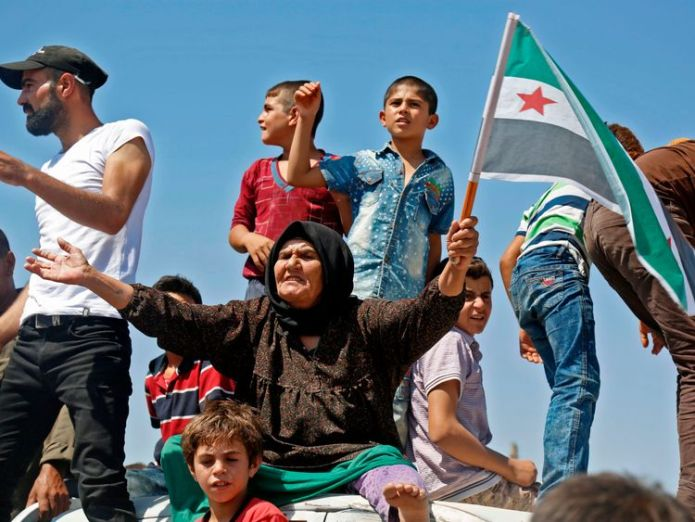The UN says 800,000 people are at risk of being displaced  Syrian rebel fighters blow up bridges as they prepare for state offensive skynews syria protest 4407346