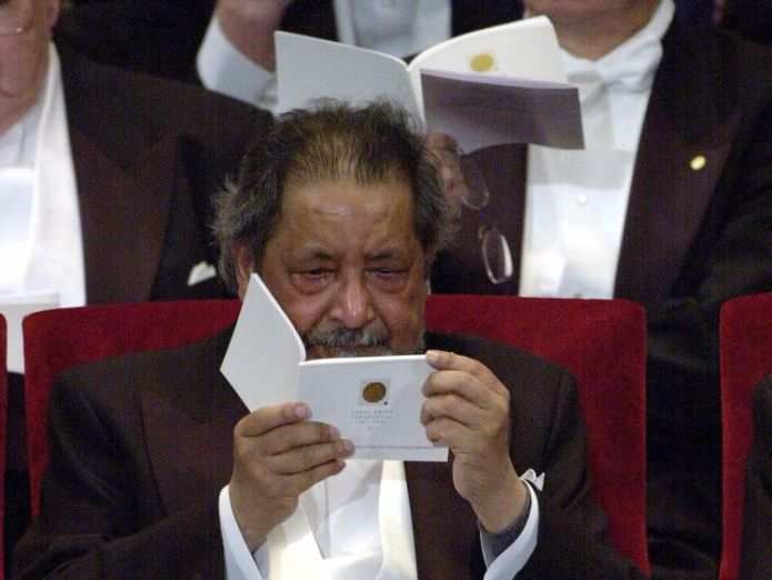 Sir V. S. Naipaul cries after recieving the Nobel Prize from King Carl Gustaf of Sweden at the Prize Award Ceremony at the Concert Hall in Stockholm December 10, 2001  Nobel Prize-winning author V S Naipaul dies skynews v s naipaul receiving nobel prize 4387564