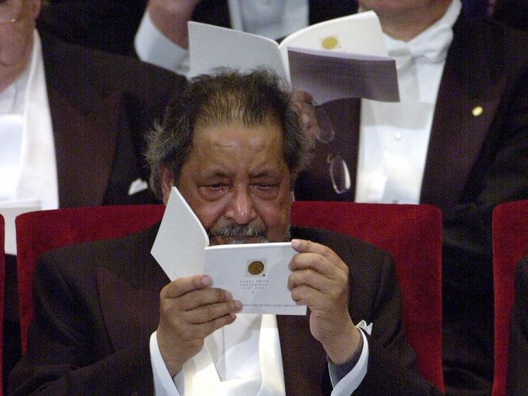 Sir V. S. Naipaul cries after recieving the Nobel Prize from King Carl Gustaf of Sweden at the Prize Award