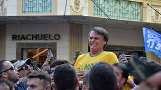 Brazilian right-wing presidential candidate Jair Bolsonaro gestures after being stabbed in the stomach  Brazil's far-right candidate Jair Bolsonaro storms presidential election round skynews jair bolsonaro brazilian presidential 4413766