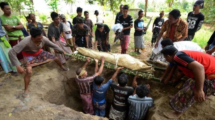 A victim from the 6.9 magnitude earthquake on 5 August is buried in northern Lombok  Five major earthquakes in two months: Indonesia reels after disasters skynews victim earthquake lombok 4437242