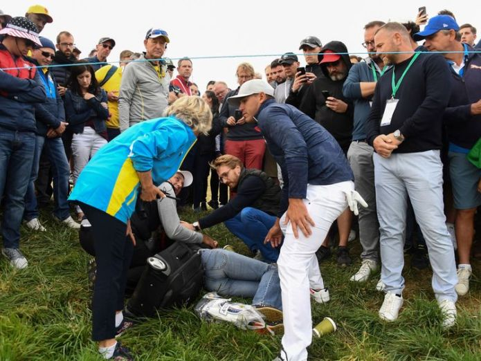 US golfer Brooks Koepka with an injured spectator  Woman injured after being hit in face by US golfer Brooks Koepka's ball at Ryder Cup skynews brooks koepka ryder cup 4436273