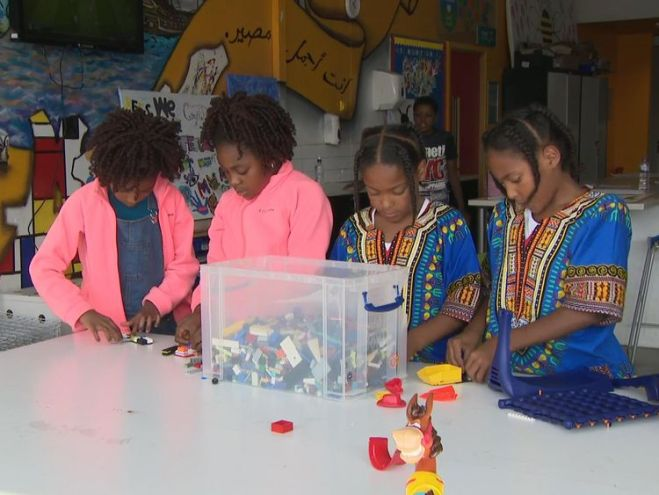 Children play with Lego at Manchester Youth Zone in Harpurhey