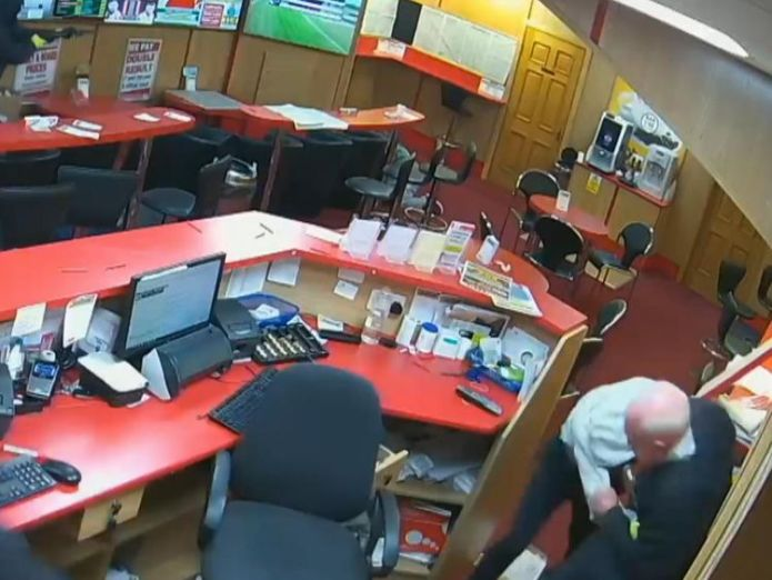 Denis O'Connor tackles one of the thieves  Great-grandfather, 83, fights off armed robbers at bookies in Ireland skynews dennis oconnor bookmakers 4424121