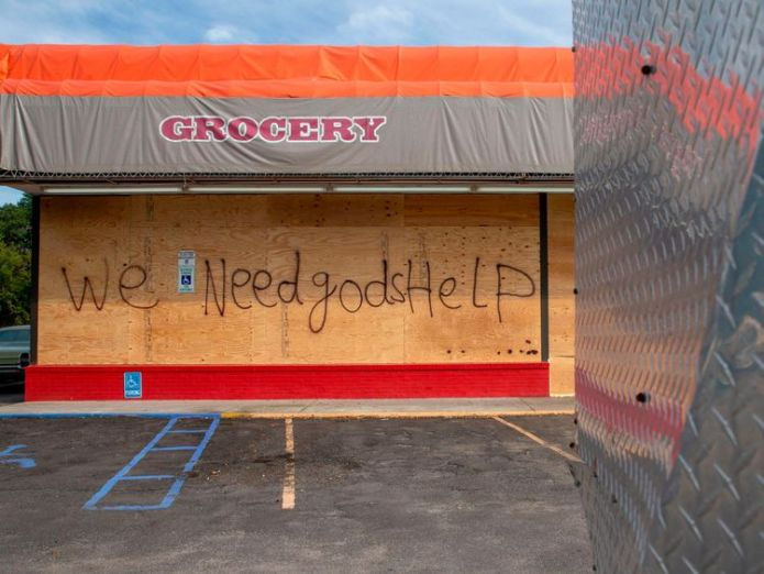 Business and homes alike have been boarded up ahead of the storm's arrival  Storm force winds for North Carolina within hours skynews hurricane florence 4419119