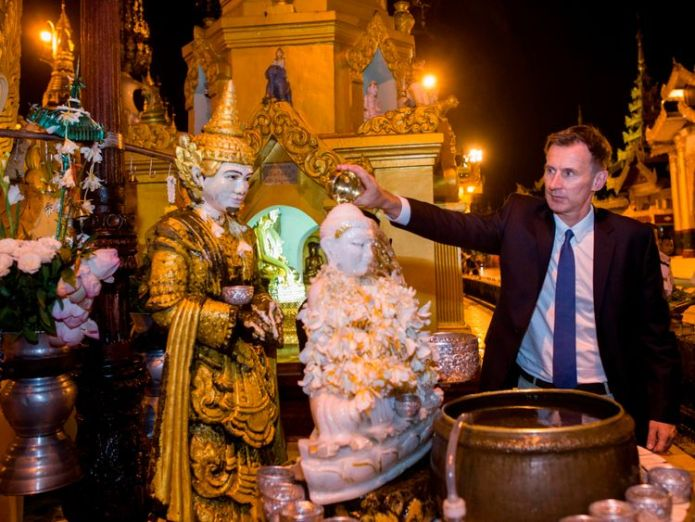 Mr Hunt visited the Shwedagon Pagoda in Yangon on his trip. It is the most sacred Buddhist pagoda in Myanmar  Jeremy Hunt warns Myanmar's Suu Kyi 'no hiding place' for Rohingyas' attackers skynews jeremy hunt myanmar 4426496