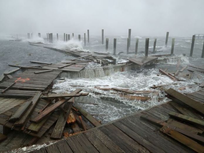 Docks and boardwalks are already being destroyed by Florence's ferocious winds  80,000 lose power as storm pummels Carolinas skynews north carolina florence 4420118