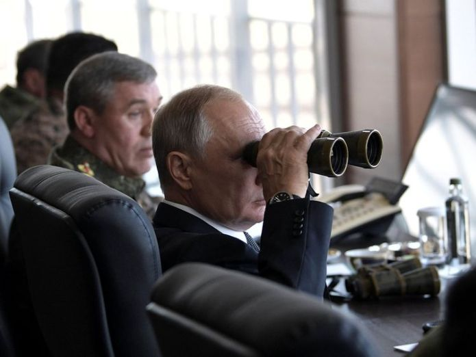 Russian President Vladimir Putin uses a pair of binoculars as he watches the Vostok-2018 (East-2018) war games  Russia's war games 'horrifying and awe-inspiring' skynews russia war games vladimir putin 4419403