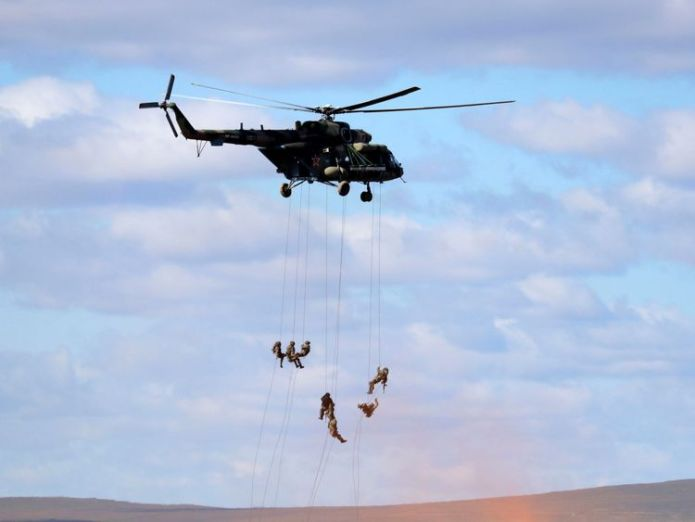 """Soldiers abseil from a military helicopter over the training ground """"Tsugol""""  Russia's war games 'horrifying and awe-inspiring' skynews russia war games 4419427"""