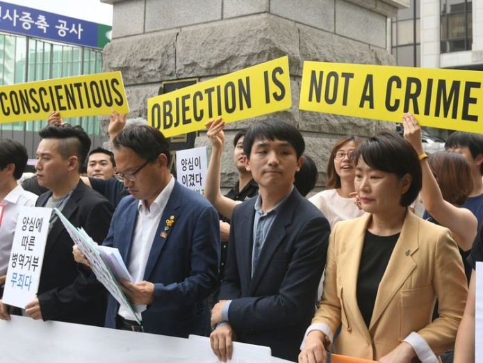 South Korean activists and conscientious objectors to military service during a rally outside the Constitutional Court in Seoul  Students 'binged on pizzas and burgers to avoid military service in South Korea' skynews south korea conscientious objectors 4419306