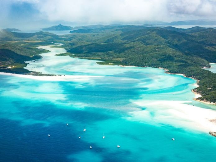 The Whitsunday Islands are off the Queensland coast  Sharks killed after attacks on woman and girl in the Great Barrier Reef skynews whitsunday islands 4427608
