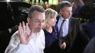 US pastor Andrew Brunson and his wife Norrine arrive at the airport in Izmir, Turkey