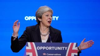 """British Prime Minister Theresa May delivers her leader's speech during the final day of the Conservative Party Conference at The International Convention Centre on October 3, 2018 in Birmingham, England. Theresa May delivered her leader's speech to the 2018 Conservative Party Conference today. Appealing to the """"decent, moderate and patriotic"""", she stated that the Conservative Party is for everyone who is willing to """"work hard and do their best"""". This year's conference took place six months before the UK is due to leave the European Union, with divisions on how Brexit should be implemented apparent throughout."""