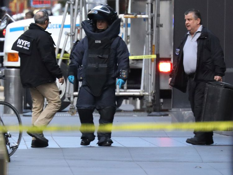 TX6GCDE24 Oct. 2018New York, UNITED STATESA member of the New York Police Department bomb squad is pictured outside the Time Warner Center in the Manahattan borough of New York City after a suspicious package was found inside the CNN Headquarters in New York, U.S., October 24, 2018. REUTERS/Kevin Coombs