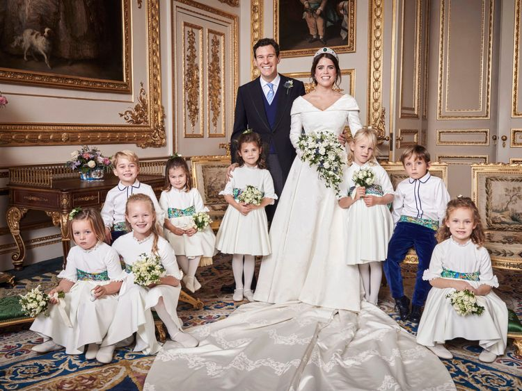 The couple posed with the bridesmaids and pageboys