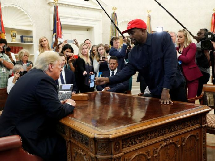 Kanye West shows Donald Trump his mobile phone in the Oval Office  Trump's stunned silence as Kanye rants in White House skynews kanye west trump 4450291
