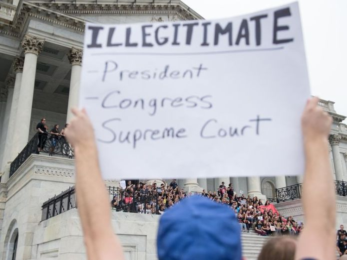 Protestors outside the Supreme Court ahead of Justice Kavanaugh's official swearing-in  Sex assault claims against Brett Kavanaugh 'a hoax' skynews kavanaugh protest supreme court 4447464