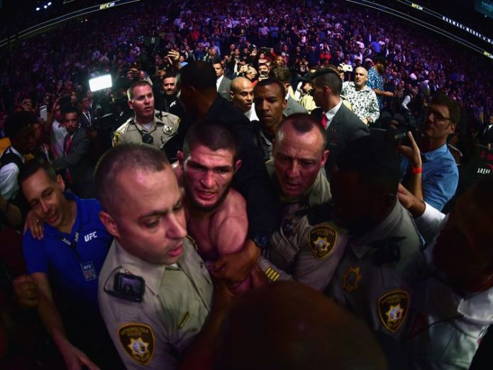 Khabib Nurmagomedov of Russia is escorted out of the arena after defeating Conor McGregor   Conor McGregor UFC contest ends in post-fight brawl skynews khabib nurmagomedov 4445906