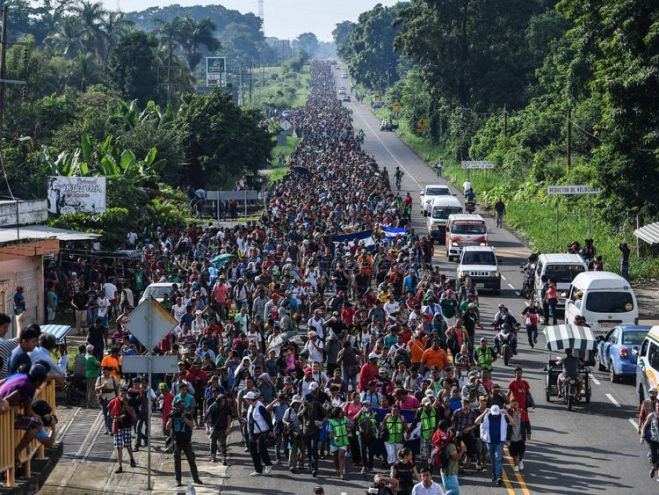 Thousands of migrants cross the Guatemala border and march north through Mexico