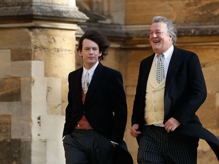 Stephen Fry arrives with his husband comedian Elliott Spencer