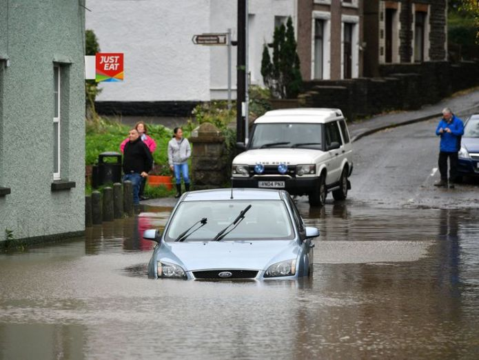 A car stranded in high tide in Tonna near Aberdulais in South Wales.