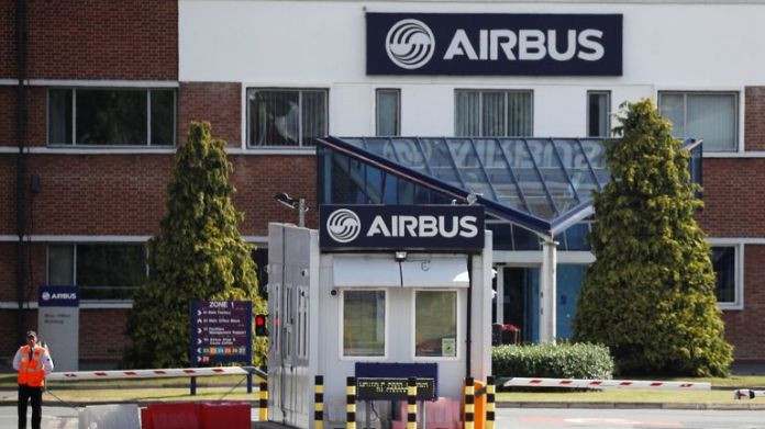 A security guard stands at the entrance to Airbus' wing assembly plant at Broughton, near Chester