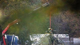 Crane moves helicopter break