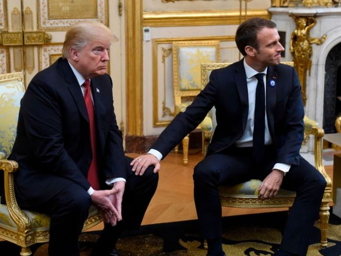 Mr Macron patted Mr Trump's knee at the end of the conference  Trump cancels Armistice cemetery visit 'due to bad weather' skynews macron trump armistice 4482384